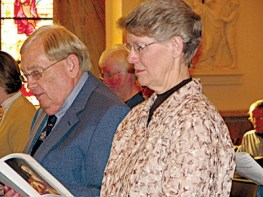 Earle Harvey and his companion Sister Mary Montgomery participate in the Rite of Commitment.