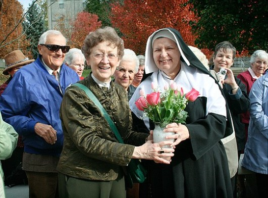 2009: Sister Barbara Doherty, who conceived the idea and was the driving force behind the Saint Mother Theodore Guerin Fest 2009, is presented with flowers in gratitude for her efforts. The presentation was made by Sister Susan Paweski, who portrayed Saint Mother Theodore Sunday.