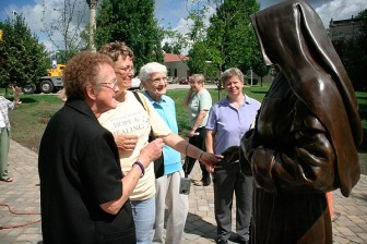 Sister Diane Ris, Teresa Clark, Sister Joann Quinkert and Sister Stacy Pierce say hello to Mother Theodore.