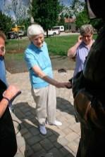Sister Joann shakes her hand.
