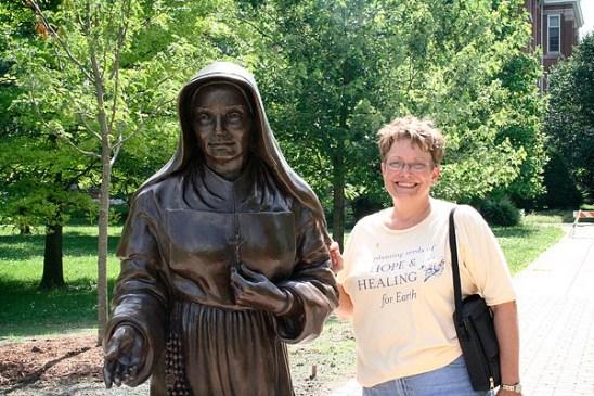 Sculptor Teresa Clark stands by her statue.