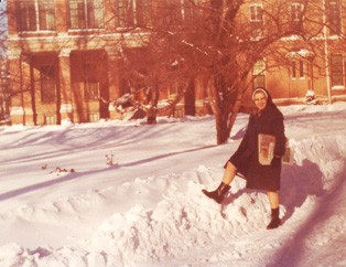 Sister Michael Ellen Green outside Providence Hall after a snowstorm.