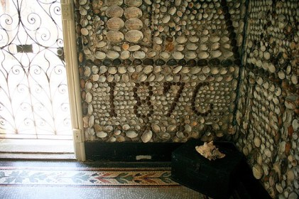"""""""1876,"""" the year that the Shell Chapel was built and Sister Mary Joseph Le Fer de la Motte finished covering the walls with shells., is worked into the shell designs on the wall."""