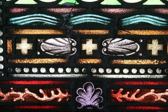 The beautiful stained glass windows feature coral and shell motifs.