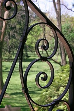 The metal scrolls on the front door are like the swirly shape of some shells. Looking out through the Shell Chapel door, one can see the lovely grounds of Saint Mary-of-the-Woods.