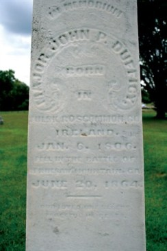 This weather-worn monument marks where Major John P. Dufficy is laid to rest.
