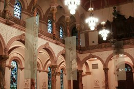 The interior of the church utilizes soft rose colors.