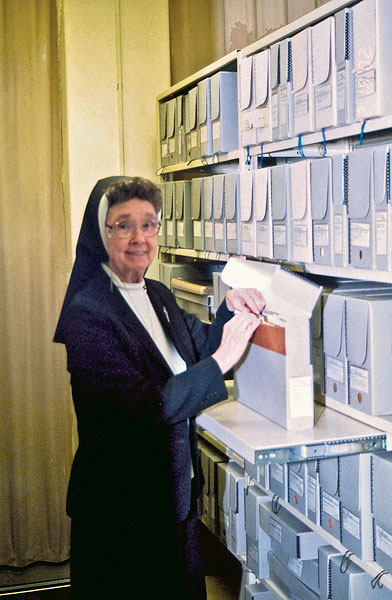 Sister Eileen Ann Kelley returns material to a Hollinger box in this 2002 photo.