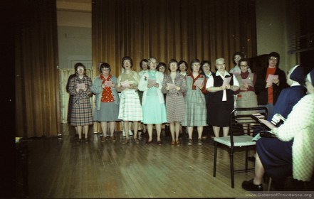 """Sisters of Providence singing at the """"Ball before the Fall,"""" a program in the north wing (the former novitiate) of Providence Hall before it was razed."""