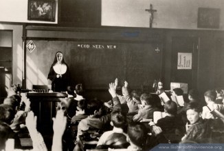 Students respond to a question by Sister Mary Lourdes Haverty (RIP).