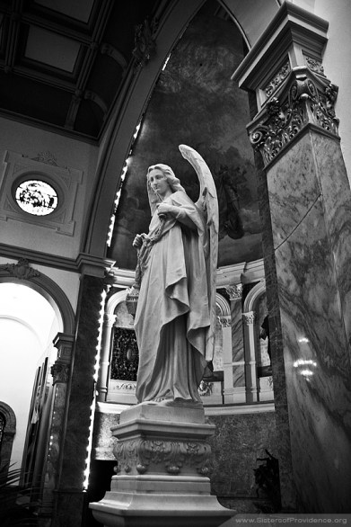 This angel stands to the left of the tabernacle in the Church of the Immaculate Conception, the chapel of the Sisters of Providence of Saint Mary-of-the-Woods, Indiana.