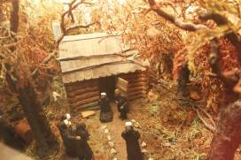 """""""Journey's End"""". After: additional color and landscape added. Upon arrival, Mother Theodore and her companions recommit themselves to the mission of Providence at the humble log cabin chapel."""