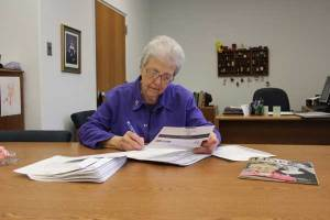 Sister Ann signs letters