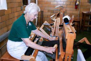 Sister Jeanne Knoerle demonstrating her weaving skills will alpaca fiber.