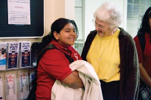 Sister Patty Fillenwarth chats with a student from the afterschool homework club at Providence Family Services in Chicago where Sister Patty ministers as both the director and a counselor.