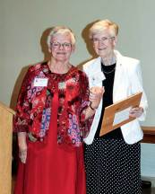 Sister Lois Stoiber, at right, accepts the 2013 Queen Amelia Award at the June 1 Saint Mother Theodore Guerin Dinner on behalf of her brother, Ray Stoiber, who was unable to attend. She is pictured with Sister Denise Wilkinson, left, general superior.