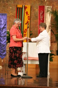 Sister Patty Wallace, right, receives from General Superior Sister Denise Wilkinson, left, a ring signifying her lifelong vows with the Sisters of Providence of Saint Mary-of-the-Woods, which she professed during a vow ceremony June 30 at Saint Mary-of-the-Woods.