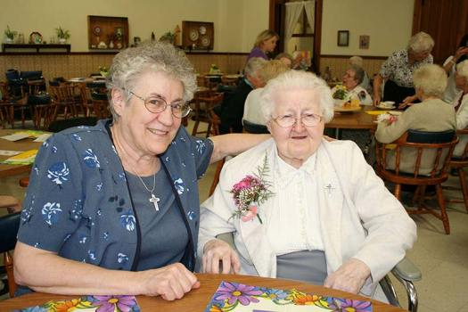 Sister Mary Eymard Campeggio, right, attends the SP over 90s party in 2006 with her guest Sister Maria Smith.