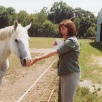 Sister Janice Smith visits with a horse at Saint Mary-of-the-Woods