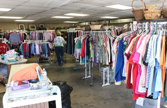 Volunteers prepare the store with new inventory on the days that it is not open. It's a big job with as many items as are purchased each time the store opens.
