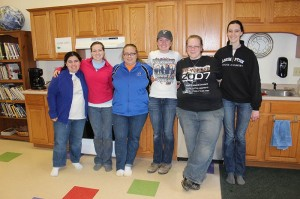 Kaitlyn, second from right, with a group of students from Butler University on a spring break service trip at White Violet Center for Eco-Justice at Saint Mary-of-the-Woods.