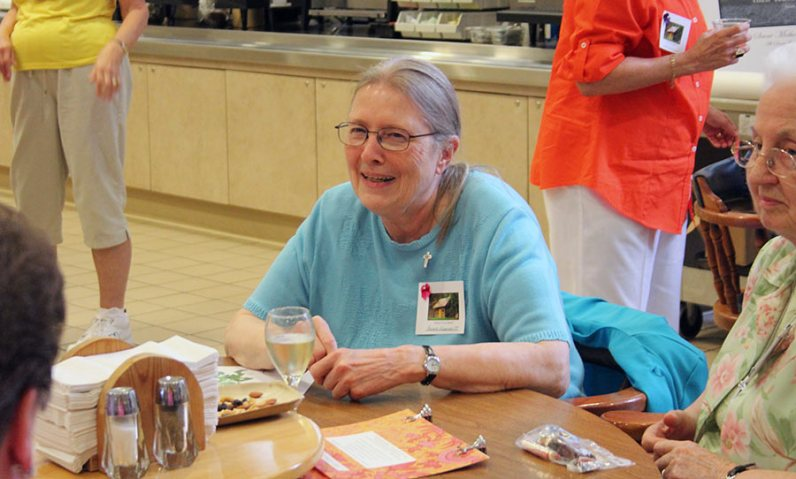 Sister Arlene Knarzer enjoys some entertainment.