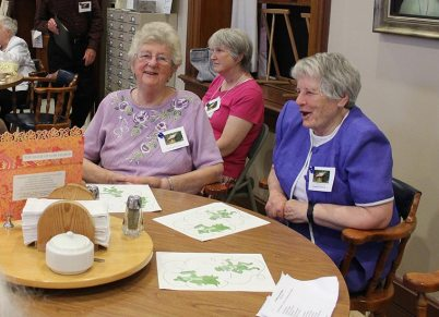 Sisters Ruth Ellen Doane and Teresea Costello enjoy the Sunday evening social with the Providence Associates