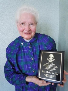 Sister Charles Van Hoy with the award she recently received from the Vigo County Democratic Party.