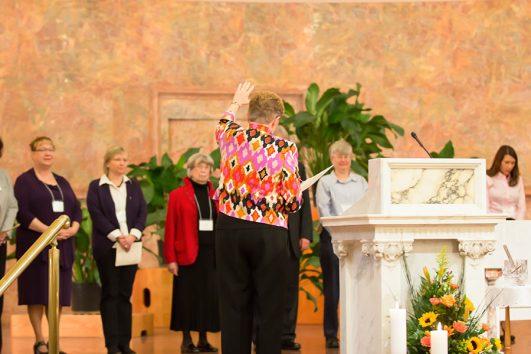 Director of Providence Associates Sister Diane Mason raises her hand in blessing over the new Providence Associates during the Nov. 8, 2014 commitment ceremony.