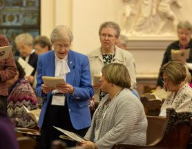 Sister of Providence Sister Rosemary Borntrager declares her companion Jennifer Calvert, seated, ready to become a Providence Associate.