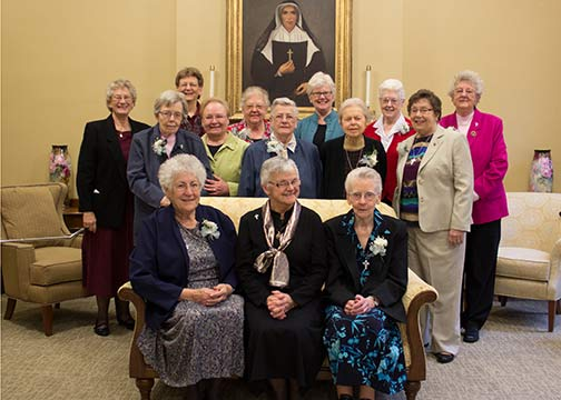 Several Sisters of Providence celebrated Jubilees in December. They were honored at a celebration with the Sisters of Providence General Council. The sisters celebrating Jubilees included (front, from left) Sister Marie Smith, General Superior Sister Denise Wilkinson and Sister Betty Donoghue, (middle) Sister Suzanne Smith, General Council member Sister Mary Beth Klingel and SIsters Marilyn Trobaugh, Mary Rita Griffin and Kathleen Dede, (back) General Council members Sisters Jenny Howard and Dawn Tomaszewski, Sister Dorothy Larson, General Council member Sister Lisa Stallings and Sisters Joseph Fillenwarth and Ruth Ellen Doane.