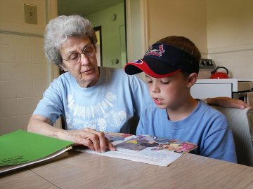 Sister Rita Clare Gerardot tutors a young boy at Educational/Family Services in 2005.