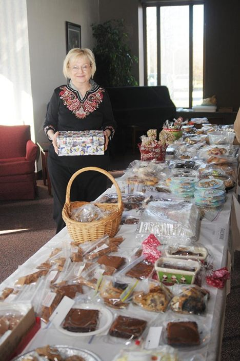 Providence Associate Judi Collins helps run a bake sale to raise funds for Educational/Family Services in 2013.