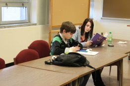 A Saint Mary-of-the-Woods College student helps a student with his homework through EFS in 2012 in Hulman Hall.