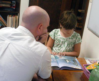 Volunteer Tom Milner tutors Brandi Reed in 2009.