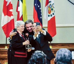 Sister Marikay Duffy poses for a selfie of her and Archbishop Joseph Tobin taken by WRTV-6 news anchor Raphael Sanchez who emceed the Intercultural Awards Dinner of the Archdiocese of Indianapolis at which she was honored. (Photo courtesy of Natalie Hoefer, Criterion)