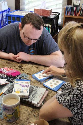 EFS Director Penny Sullivan helps student Dustin Drisko learn basic money skills.