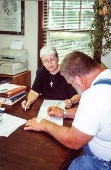 Then-Director of Educational/Family Services Sister Margaret Quinlan works with an adult student in 2000.