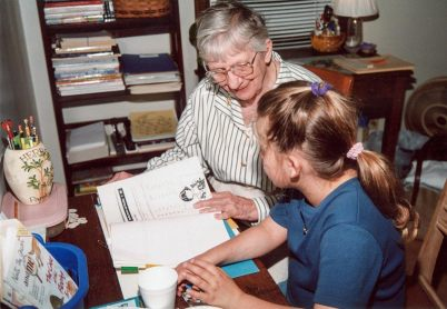 Sister Marilyn Therese Lipps tutors a girl at EFS in 2002.