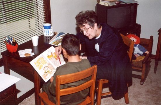 Mickie Lane Fredericks tutors a child after school in 2002.