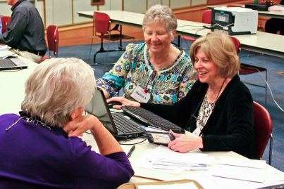 One way that Providence Associate Marilyn Neuman, center, lives out her commitment as a Providence Associate is by volunteering to help senior citizens file their taxes at the local library in Arlington Heights, Illinois.