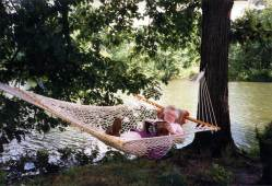Sister Bernice Kuper relaxes with a book in a hammock at St. Joseph's Lake years ago.