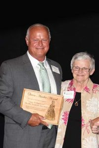 Terre Haute Convention and Visitors Bureau Executive Director David A. Patterson (left) accepted the Queen Amelia award from Sisters of Providence General Superior Sister Denise Wilkinson during the Saint Mother Theodore Guerin Dinner, which took place on Saturday, June 6, at Saint Mary-of-the-Woods.