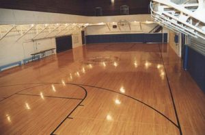"""An inside photo of the basketball court inside the """"Old Gym."""""""