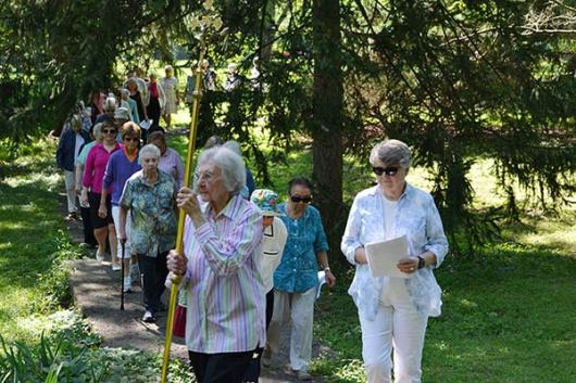 Many Sisters of Providence and others walk toward the Saint Anne Shell Chapel during the Saint Anne Procession on Friday, July 24.