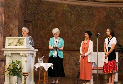 From left, Sisters Denise Wilkinson, Marsha Speth, Anna Fan and Tracey Horan. Anna and Tracey await the blessing and presentation of their white SP crosses.