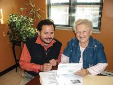 Sister Betty Smigla, shown accompanying a client at Taller de Jose in Chicago, puts her fluency in the Spanish language to good use in her ministry walking with and advocating for clients who need help navigating social, legal, financial or other systems. (Photos coutesy of Taller de Jose)