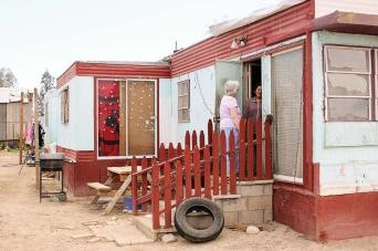 Sister Loretta (formerly Sister Loretta Joseph) checks in on a former student at her trailer home.