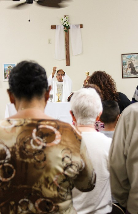 The sisters join the people they serve at Mass in a local community center used to house Sunday services for the growing immigrant population in the area.