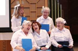 "2015: Providence Associates (front, from left) Sheila Donis, Sharon Michaud, Diann Neu, (back) Mel Wolff and Donna Kehoe performing in ""To God Through Music"" skit"
